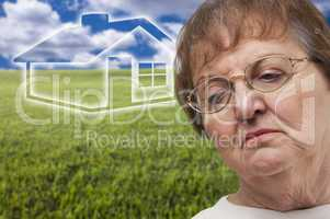 Melancholy Senior Woman with Grass Field and Ghosted House Behin