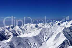 view on off-piste slopes and multicolor blue sky at nice sunny d