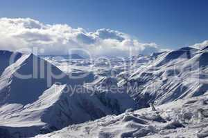 speed flying in sunny winter mountains