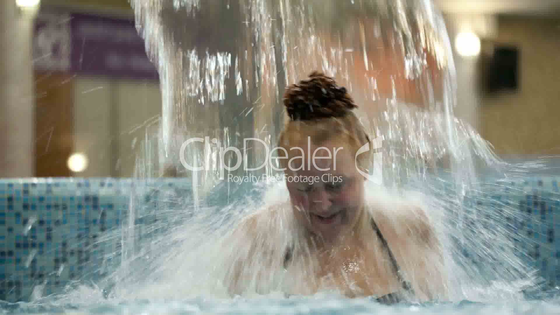 Middle Aged Woman Under Water Stream In The Swimming Pool Royalty Free Video And Stock Footage