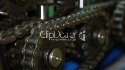 Chain mechanism of the press machine.