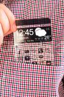 smartphone with a transparent screen in a shirt pocket.