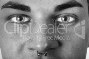 form-fitting portrait of a pierced man