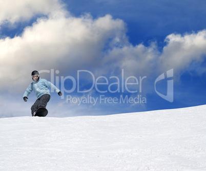 snowboarder on ski slope at nice day