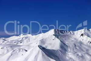 view on off-piste snowy slope at sunny day