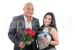 couple holding ring and flowers isolated.  anniversary and engag