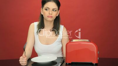 Hungry woman with an empty dinner plate