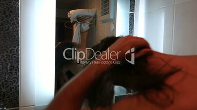 attractive man drying hair
