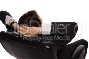 relaxed businessman sitting in a comfortable chair