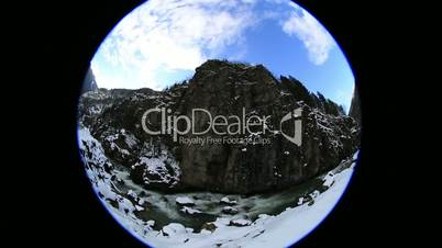 fish eye time lapse flowing river and clouds in winter