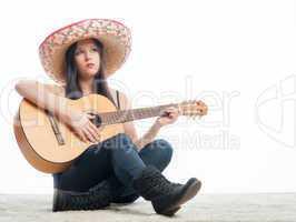 brünettes mädchen mit gitarre