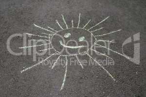 sun drawing on asphalt
