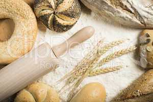 breads. pile of flour, rolling pin and wheat