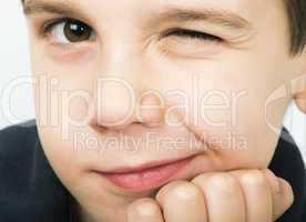 little boy wink of an eye