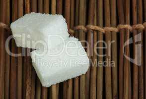 sugar lumps on wooden base