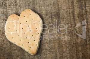 heart shape cookie on wooden background