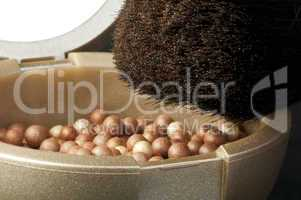 make up brush and pearls