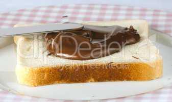 liquid chocolate on a slice of bread
