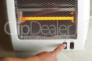 electric heater and hand which includes switch