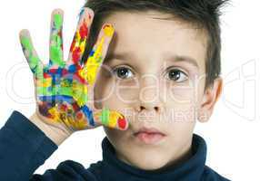 boy hand painted with colorful paint