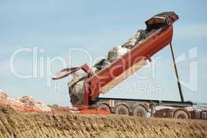 trailer of truck unloads stones