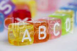 Text A B C on colorful wooden cubes