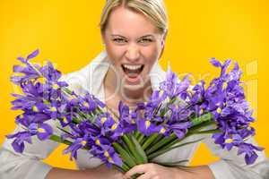 woman with spring iris flower roar
