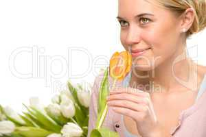 romantic woman smell one orange tulip flower