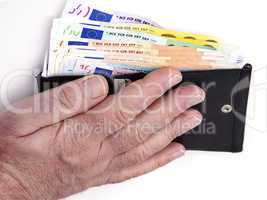 hand reaching for wallet with banknotes