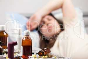 Unwell woman patient lying down bed