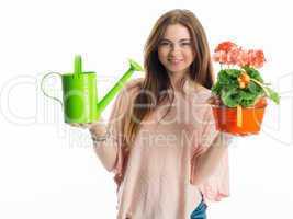 Mädchen hält eine Topfpflanze