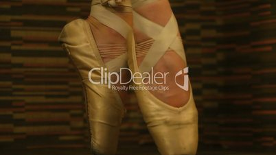 Woman in ballet shoes standing en pointe