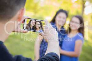 Man Takes Cell Phone Picture of Wife and Daughter