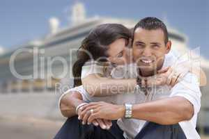 Young Happy Hispanic Couple In Front of Cruise Ship