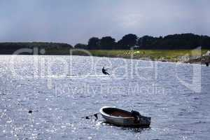 kitesurfer with motorboat