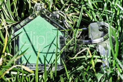 Shape of a house on grass and keys