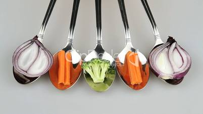 vegetables in spoon one