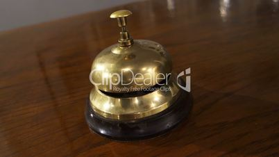 Bell - impatient guest rings several times at hotel reception