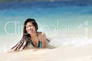 young filipina woman swimming in the sea