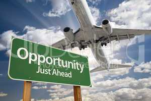 Opportunity Green Road Sign and Airplane Above