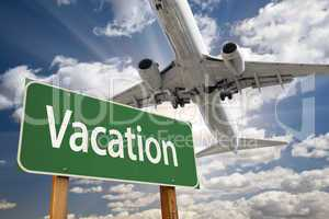 Vacation Green Road Sign and Airplane Above