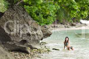 woman swimming on a beautiful lush seashore