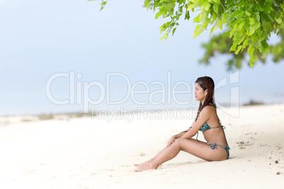 beautiful filipina woman on a tropical beach