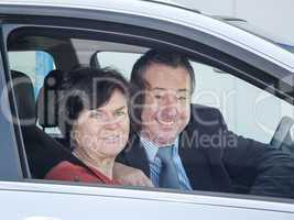 woman and man in car
