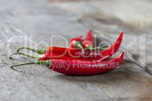 chillies on wooden table