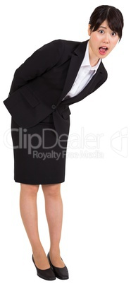 Surprised businesswoman bending