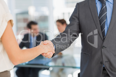 Mid section of handshake to seal a deal after meeting