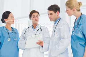 Doctors looking at report in hospital