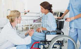 Doctor talking to a patient in wheelchair at hospital