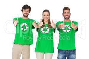 People in recycling symbol t-shirts gesturing thumbs up